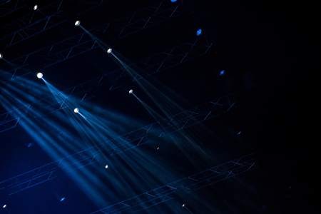 Blue stage lights. Illumination with spotlights at a concert