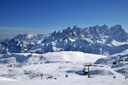 Ski paradise in the Italian Dolomites. Ski lift, piste, slopes in the Alps