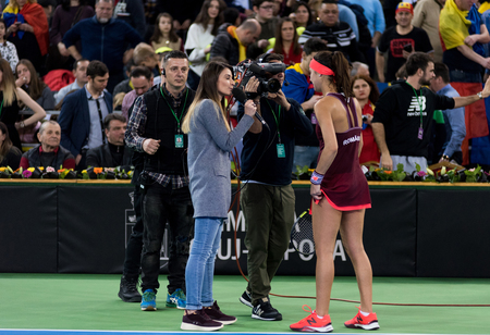CLUJ NAPOCA, ROMANIA - FEBRUARY 10, 2018: Romanian tennis player Sorana Cirstea answering questions during an interview after she won a Fed Cup tennis match against Canada