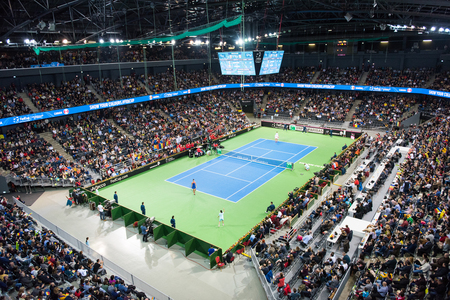 CLUJ NAPOCA, ROMANIA - FEBRUARY 10, 2018: Romania playing tennis Canada during a Fed Cup match in the Polivalenta Hall indoor court. Crowd of people, fans supporting their team