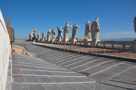 The roof of Madernos Facade of Saint Peters Basilica, features statues of Jesus and 11 of the Apostles along with John the Baptist. Vatican city