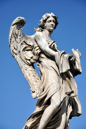 Statue of an Angel with the Garment and Dice. SantAngelo bridge, Rome, Italy