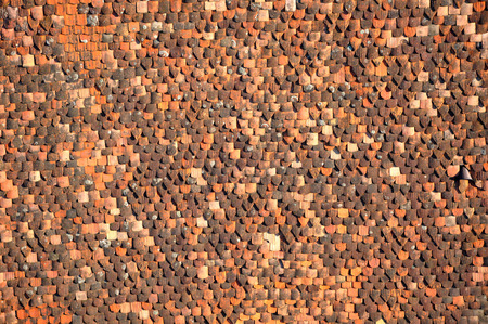 Pattern of old tile roof. Background of house roof tiles