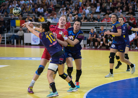 CLUJ NAPOCA, ROMANIA - MARCH 25, 2018: National team of Romania playing handball against Russia during 2018 Womens European Championship Qualification phase 2 Editorial