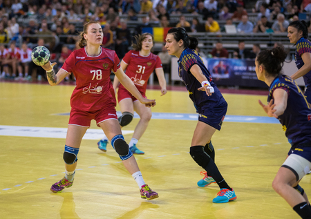 CLUJ NAPOCA, ROMANIA - MARCH 25, 2018: National team of Romania playing handball against Russia during 2018 Women's European Championship Qualification phase 2 Editorial