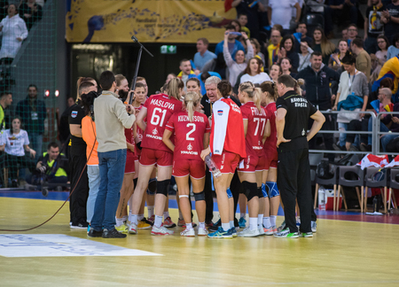 CLUJ NAPOCA,ROMANIA - MARCH 25, 2018: Coach of Russia talking with the women handball players during a time out break at a match against Romania