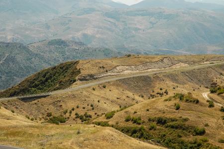 Road in arid, deserted landscape in Northern Kurdistan, Turkey
