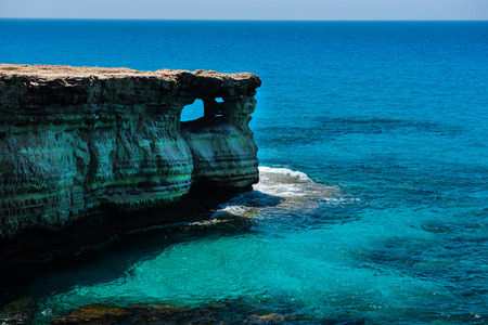 Sea caves (littoral caves) near Ayia Napa, Mediterranean sea coast, Cyprus. They are formed primarily by the wave action of the sea Banque d'images
