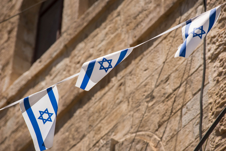 The flag of Israel blowing in the wind. Star of David Imagens