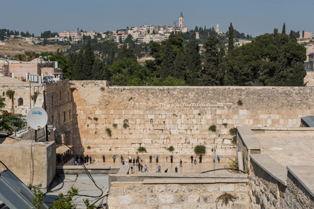 JERUSALEM, ISRAEL - MAY 15, 2018: Jewish people and tourists praying at the Western or Wailing wall,  the most sacred place for Judaic religion