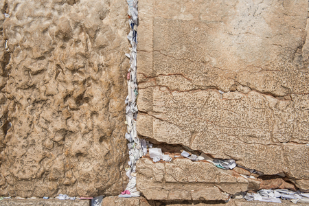 JERUSALEM, ISRAEL - MAY 15, 2018: The cracks of the Western Wall are full with placing notes, containing written prayers to God