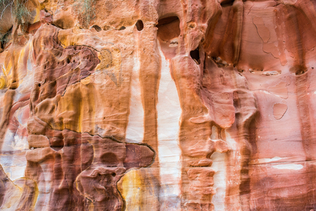 Colorful, red sandstone formation texture. Abstract geological pattern. Petra, Jordan