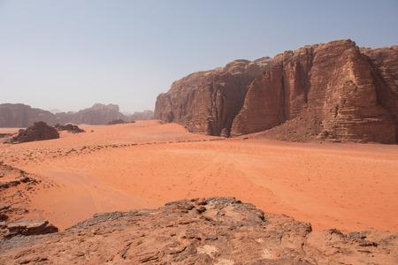 Scenic view of Wadi Rum desert, Jordan. Sand dunes and sandstone cliffs view from Khor El Ajram rock