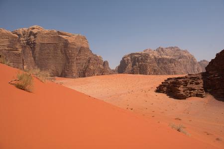 Red sand dunes and sandstone cliffs in Wadi Rum desert, Jordan