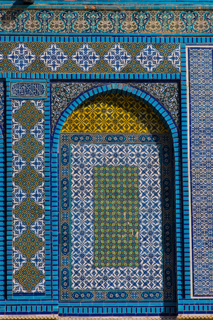 Colorful Islamic patterns, window covered with Arabic  screen, mosaic tiles. Dome of the Rock, Temple Mount mosque, Jerusalem, Israel Stock Photo