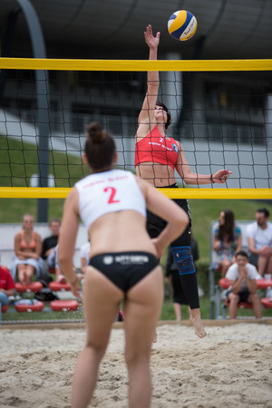 CLUJ, ROMANIA - JUNE 17, 2018: Girl in bikini playing beach volleyball during the Sports Festival