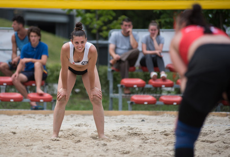 CLUJ, ROMANIA - JUNE 17, 2018: Girl in bikini playing beach volleyball during the Sports Festival