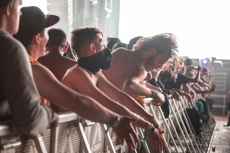 BONTIDA, ROMANIA - JULY 21,  2018: Crowd of partying people headbanging during a Dj Excision live set at Electric Castle festival Editorial