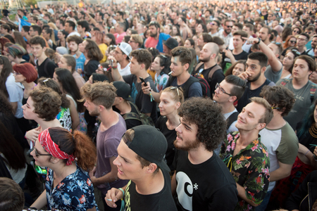 BONTIDA, ROMANIA - JULY 21, 2018: Crowd of cheerful fans dancing and partying during a Subcarpati live concert at Electric Castle festival