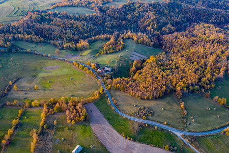 Aerial drone view of a countryside dirt road at autumn Stockfoto