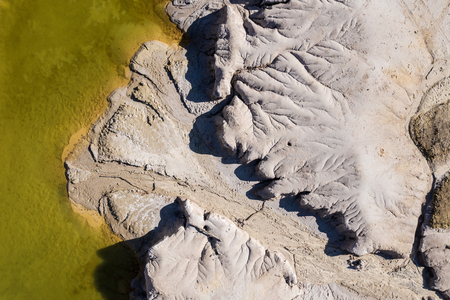 Surrealistic aerial image of abandoned opencast mine. Bad land pattern and lake from a drone Banque d'images