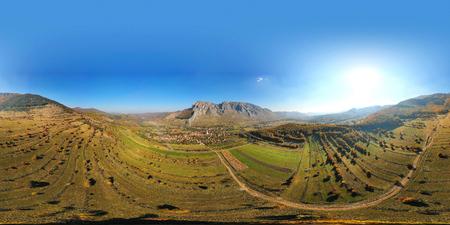 Aerial drone 360 panorama image of Piatra Secuiului (Szekelyko) mountain and Rimetea (Torocko) village in Transylvania, Romania