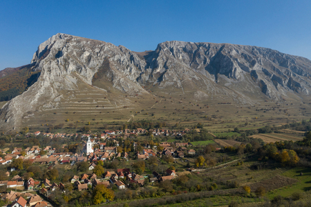 Aerial drone view of Piatra Secuiului (Szekelyko) mountain and Rimetea (Torocko) village in Transylvania, Romania