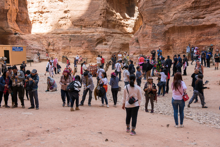 PETRA, JORDAN - MAY 17, 2018: Tourists visiting the Unesco heritage site of Petra, one of the New Seven Wonders of the World