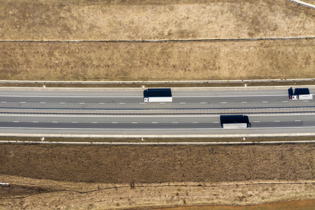 Aerial top view of cars and trucks passing on a highway, drone shot Reklamní fotografie