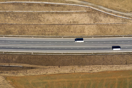 Aerial top view of cars and trucks passing on a highway, drone shot 版權商用圖片