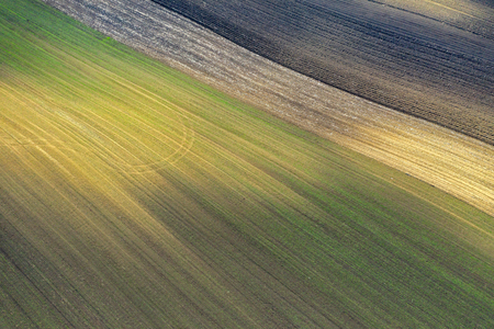 Aerial view of bio based industry and agriculture, plowed terrain in the spring from drone