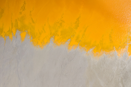 Abstract aerial view, pattern of orange chemical residuals from copper mining
