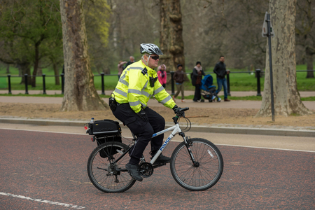 LONDON, UK - MARCH 22, 2019: Metropolitan Police Cycles Officer patrolling on bicycle on the streets of Central London