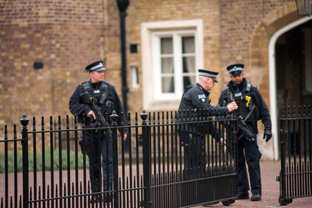LONDON, UK - MARCH 22, 2019: Armed British police officers on duty patrolling and preventing terrorism attacks on the streets of the city