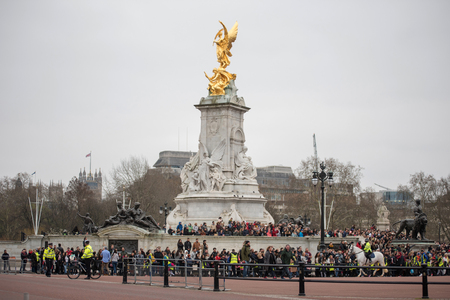 LONDON, UK - MARCH 22, 2019: Crowd of tourists watching the Changing the Guards Military Parade in the front of the Buckingham Palace