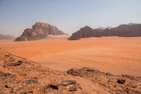 Majestic sand desert and gigantic rocks in Wadi Rum, one of the major tourist attractions of Jordan and the Middle East