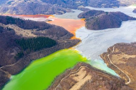Ecological catastrophe, aerial view of a lake filled with chemical residuals from copper mine exploitation by drone. Geamana, Rosia Montana, Romania