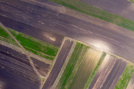 Aerial drone view of agricultural fields of crops plowed and prepared for planting in the spring