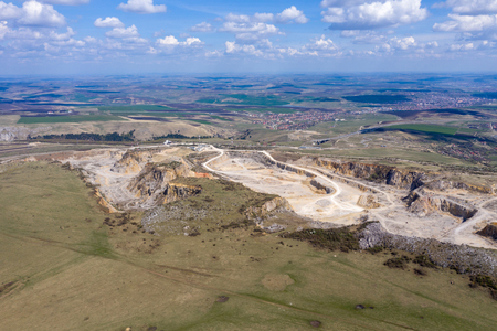 Aerial drone view of a limestone quarry, open pit mine, mining industry