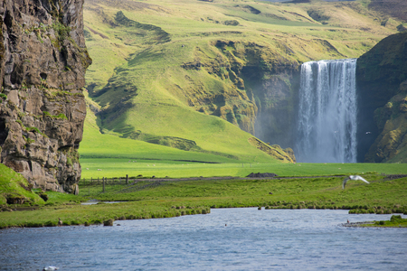 Skogafoss waterfall, on the Ring Road in Southern Iceland, is one of country's most epic tourist destinations