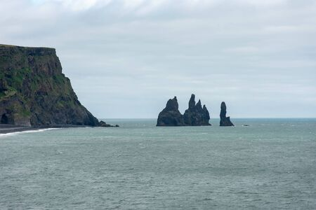 Reynisdrangar basalt sea stacks in the Atlantic ocean, Vik, Iceland