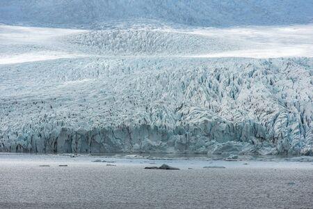 Floating icebergs drifting in the water in Fjallsarlon glacier lagoon, Vatnajokull National Park, Iceland. Global warming concept