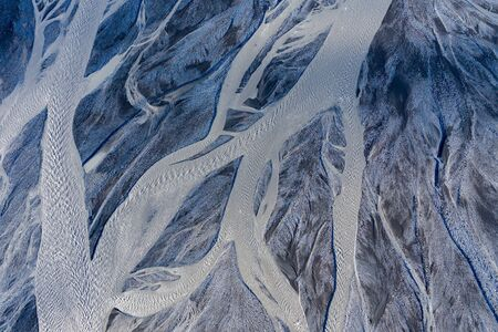 Aerial drone view of a huge riverbed and delta, glacial river system transporting deposits from the Eyjafjallajokull volcano glacier showing unique patterns, Iceland