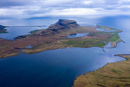 Aerial view of the Atlantic ocean and Snaefellsnes penisula near Kirkjufell mountain, Iceland by drone