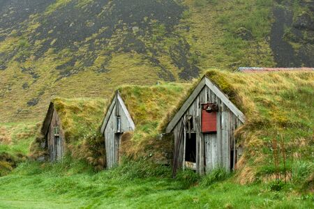 Abandoned historic turf house farm buildings in Nupsstadur, Iceland Stock Photo