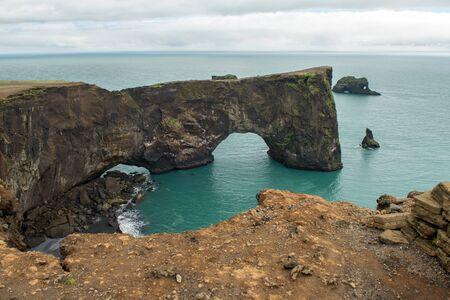 Dyrholaey rock arch in the coast of the Atlantic ocean. Vik, Iceland