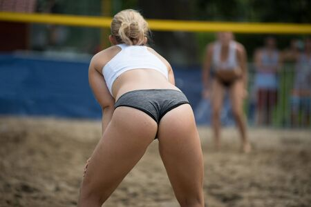 Girl playing beach volleyball