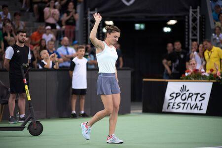 CLUJ, ROMANIA - JUNE 15, 2019: Tennis player legend Simona Halep entering the court at a match against Daniela Hantuchova during the Sports Festival Editöryel