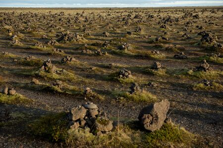 Traditional cairns made of stones on a lava ridge, Laufskalavarda Southern Iceland Stock fotó