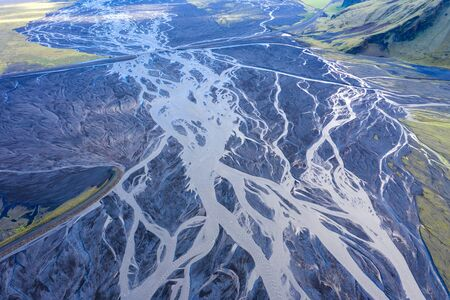 Aerial drone view of a huge riverbed, melting glacier, Iceland. Global warming and climate change concept Stock Photo